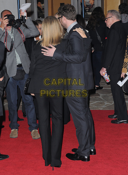 "Barbra Streisand & Seth Rogen .""The Guilt Trip"" Los Angeles Premiere held at the Regency Village Theatre, Westwood, California, USA..December 11th, 2012.full length clutch bag funny black suit grey gray back behind rear arms around shoulders posing .CAP/DVS.©DVS/Capital Pictures."