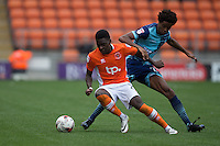 Sido Jombati of Wycombe Wanderers looks to win the ball back from Bright Osayi-Samuel of Blackpool during the Sky Bet League 2 match between Blackpool and Wycombe Wanderers at Bloomfield Road, Blackpool, England on 20 August 2016. Photo by James Williamson / PRiME Media Images.
