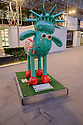 London, UK. 07.04.2015. Shaun the Sheep, charity sculptures, London, UK. Liberty Bell, Fenchurch Street Station. Photograph © Jane Hobson.
