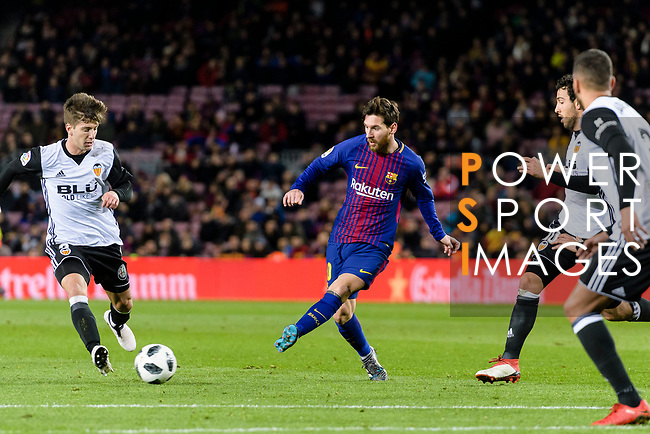 Lionel Messi of FC Barcelona (C) in action against Luciano Vietto of Valencia CF (L) during the Copa Del Rey 2017-18 match between FC Barcelona and Valencia CF at Camp Nou Stadium on 01 February 2018 in Barcelona, Spain. Photo by Vicens Gimenez / Power Sport Images