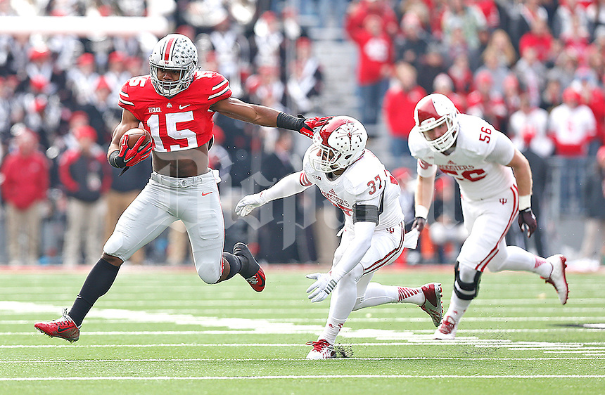 Ohio State Buckeyes running back Ezekiel Elliott (15) holds off Indiana Hoosiers safety Mark Murphy (37) for a gain in the first quarter at Ohio Stadium on 22, 2014. (Chris Russell/Dispatch Photo)