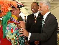 TALLAHASSEE, FL. 4/21/04-Boyd Wynne III, a member of Ye Mystic Krewe of Gasparilla, left, shares a laugh with Sen. Les Miller, D-Tampa, and Attorney General Charlie Crist, right, during Hillsborough County Day Wednesday, at the Capitol in Tallahassee. Sen. Victor Crist, R-Tampa, said the event was designed to build off of what Ybor City Day was and incorporate elements from more than 30 public and business groups to showcase what the county has to offer...COLIN HACKLEY PHOTO