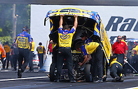 Jun. 2, 2013; Englishtown, NJ, USA: Crew members work under the body of NHRA funny car driver Matt Hagan during the Summer Nationals at Raceway Park. Mandatory Credit: Mark J. Rebilas-