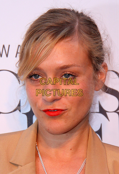 CHLOE SEVIGNY.Swarovski CRYSTALLIZED partners with Blake Lively and not-for-profit organization charity water for opening of New York City Swarovski CRYSTALLIZED Concept Store, New York, NY, USA..June 25th, 2009.headshot portrait orange red lipstick beige .CAP/ADM/PZ.©Paul Zimmerman/AdMedia/Capital Pictures.