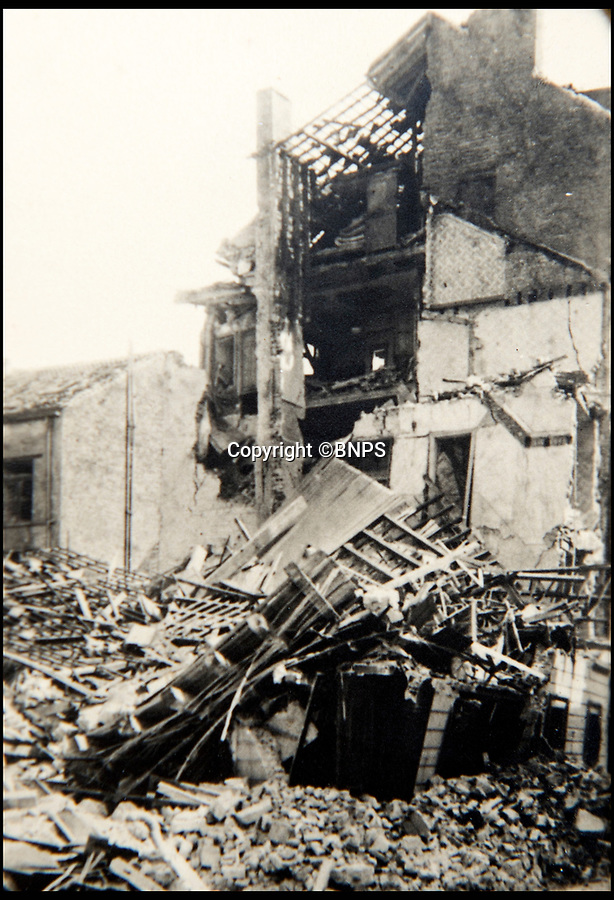 BNPS.co.uk (01202 558833)<br /> Pic: BNPS<br /> <br /> A building completly destroyed on the promenade in La Panne, Belgium.<br /> <br /> Haunting photos which capture the trail of devastation left in the wake of the Dunkirk evacuation have been unearthed after 77 years.<br /> <br /> The poignant pictures were taken soon after 330,000 Allied troops had been rescued from the beaches by an armada of little ships having been defeated by the Germans.<br /> <br /> The epic operation is about to be the subject of the new Hollywood blockbuster movie 'Dunkirk' will stars Tom Hardy and Harry Styles and is die for release on July 21.<br /> <br /> The black and white snaps show German soldiers surveying the wreckage which included destroyed ships and large military trucks lying in the surf.<br /> <br /> They are being sold by Duke's Auctioneers.
