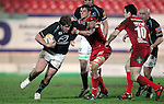 Peter Borlase hands off Aaron Shingler..RaboDirect Pro12.Scarlets v Connacht.02.03.12.©STEVE POPE