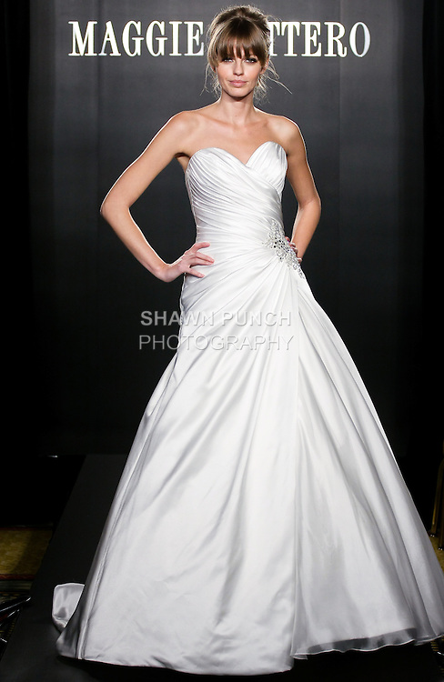 Model walks the runway in a Dixie Couture wedding dress from the Maggie Sottero Bridal Spring 2012 collection, during  Couture: New York Bridal Fashion Week 2012