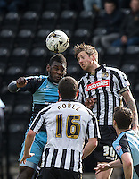 Jonathan Stead of Notts County & Aaron Pierre of Wycombe Wanderers go for the ball during the Sky Bet League 2 match between Notts County and Wycombe Wanderers at Meadow Lane, Nottingham, England on 28 March 2016. Photo by Andy Rowland.