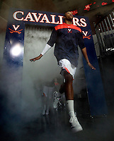 CHARLOTTESVILLE, VA- NOVEMBER 26: Akil Mitchell #25 of the Virginia Cavaliers runs onto the court  during the game on November 26, 2011 at the John Paul Jones Arena in Charlottesville, Virginia. Virginia defeated Green Bay 68-42. (Photo by Andrew Shurtleff/Getty Images) *** Local Caption *** Akil Mitchell