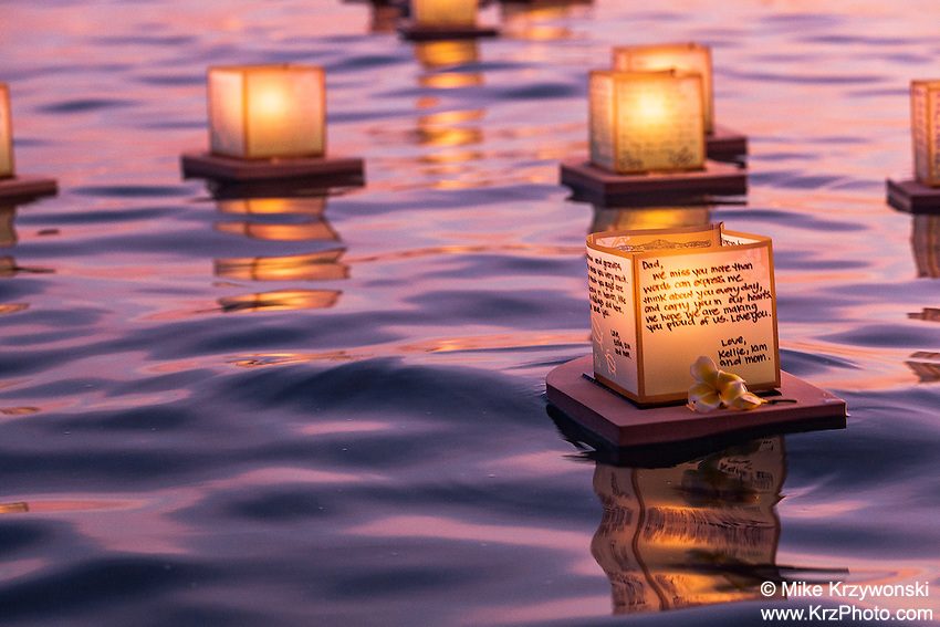 Candles floating in the water at the 15th annual lantern floating ceremony at Ala Moana Beach Park  on Memorial Day