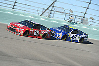HOMESTEAD, FL - NOVEMBER 19: Dale Earnhardt Jr. and Jimmie Johnson drive during the Monster Energy NASCAR Cup Series Championship Ford EcoBoost 400 at Homestead-Miami Speedway on November 19, 2017 in Homestead, Florida. Credit: mpi04/MediaPunch /NortePhoto.com