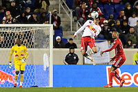 Mike Petke (12) of the New York Red Bulls heads the ball as Collins John (15) of the Chicago Fire looks on during the second half of a Major League Soccer match between the New York Red Bulls and the Chicago Fire at Red Bull Arena in Harrison, NJ, on March 27, 2010. The Red Bulls defeated the Fire 1-0.