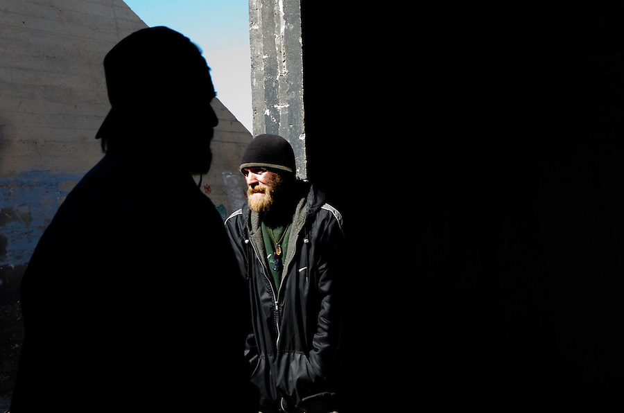 Niland, Calif., February 15, 2008 ? Inside one of the bunkers on the fringe of Slab City, Justin Davis, right, stands watch for his friends who play in a local band called Air Racket. The band, which usually plays on a makeshift stage nearby, relocated to the bunkers to get away from a storm blowing in. The bunkers, which once held munitions for the Marine base Camp Dunlap, are now a popular place for seasonal squatters and those looking to escape the intense storms from the Salton Sea...
