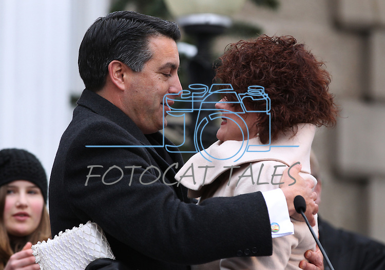 Nevada Gov. Brian Sandoval hugs his wife Kathleen after taking the oath of office during Monday's inauguration, Jan. 3, 2011 at the Capitol in Carson City, Nev. <br /> Photo by Cathleen Allison