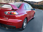 Motion photo of a 2009 Mitsubishi Lancer Evolution MR driving on Encinal Canyon Road in Malibu, California.