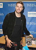Joel Dommett, signs copies of his debut book, &quot;It's Not Me, It's Them&quot;, which follows a series of disastrous romantic encounters. WH Smith, Midsummer Arcade, Milton Keynes, UK on Wednesday February 7th 2018<br /> CAP/ROS<br /> &copy;Steve Ross/Capital Pictures
