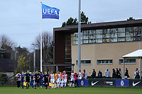 Referee, Kristo Tohver, leads out the two teams onto the field of play with the UEFA flag in the background during Chelsea Under-19 vs Montpellier HSC Under-19, UEFA Youth League Football at the Cobham Training Ground on 13th March 2019