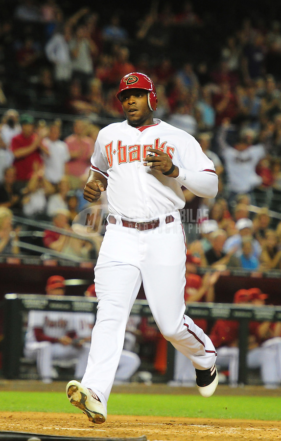May 8, 2012; Phoenix, AZ, USA; Arizona Diamondbacks outfielder Justin Upton scores in the ninth inning against the St. Louis Cardinals at Chase Field. Mandatory Credit: Mark J. Rebilas-