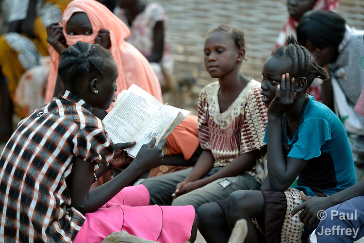 A girl leads a Roman Catholic catechism class in Agok, a town in the contested Abyei region where tens of thousands of people fled in 2011 after an attack by soldiers and militias from the northern Republic of Sudan on most parts of Abyei. Although the 2005 Comprehensive Peace Agreement called for residents of Abyei--which sits on the border between Sudan and South Sudan--to hold a referendum on whether they wanted to align with the north or the newly independent South Sudan, the government in Khartoum and northern-backed Misseriya nomads, excluded from voting as they only live part of the year in Abyei, blocked the vote and attacked the majority Dinka Ngok population. The African Union has proposed a new peace plan, including a referendum to be held in October 2013, but it has been rejected by the Misseriya and Khartoum. The Catholic parish of Abyei, with support from Caritas South Sudan and other international church partners, has maintained its pastoral presence among the displaced and assisted them with food, shelter, and other relief supplies