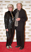 "Skitch Henderson and his wife, Ruth, arrive at the Harry S. Truman Building (Department of State) in Washington, D.C. on December 4, 2004 for a dinner hosted by United States Secretary of State Colin Powell.  At the dinner six performing arts legends will receive the Kennedy Center Honors of 2004.  This is the 27th year that the honors have been bestowed on ""extraordinary individuals whose unique and abundant artistry has contributed significantly to the cultural life of our nation and the world"" said John F. Kennedy Center for the Performing Arts Chairman Stephen A. Schwarzman.  The award recipients are: actor, director, producer, and writer Warren Beatty; husband-and-wife actors, writers and producers Ossie Davis and Ruby Dee; singer and composer Elton John; soprano Joan Sutherland; and composer and conductor John Williams.<br /> Credit: Ron Sachs / CNP"