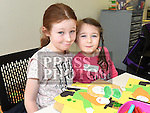 Emily and Aoife Nevin at the St. Patrick's day art workshop in the library. Photo:Colin Bell/pressphotos.ie