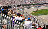 The crowd watches the start of the Aaron's 499 at Talladega Superspeedway, Talladega, AL, April 17, 2011.  (Photo by Brian Cleary/www.bcpix.com)