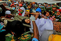 A Bangladeshi garment worker who was pulled alive from the rubble is carried on a stretcher from the site of a building that collapsed Wednesday in Savar, near Dhaka, Bangladesh, Friday, April 26, 2013.
