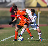 Alex Martinez (15) of North Carolina State fights for the ball with Daniel Lauretano (30) of Virginia Tech during the game at Ludwig Field in College Park, MD. Virginia Tech defeated North Carolina State, 3-2, in the ACC tournament play-in game.