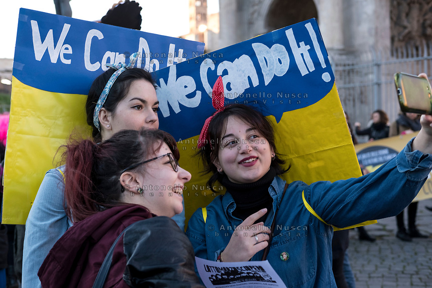 Rome, March 8, 2017. Women take a selfie in front of the Colosseum during a demonstration demanding equal rights for women and men, on the occasion of the Women's Day, in Rome.
