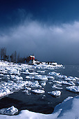 USCG Station Marquette lighthouse in Michigan's Upper Peninsula during early winter.
