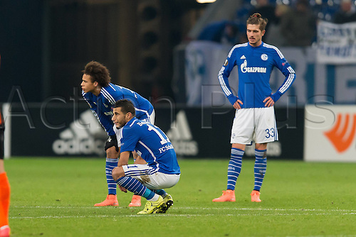 25.02.2016. Gelsenkirchen, Germany. Europa League Round of 32 Second Leg soccer match between Schalke 04 and FC Shakhtar Donetsk in the Veltins Arena in Gelsenkirchen, Germany.  Leroy SANE (S04), Younes Belhanda (S04) and Roman NEUSTAEDTER (S04) dejected at the score