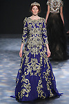 Model Delaney walks runway in a royal blue organza A-line gown with antique gold 3D floral embroidery, from the Marchesa Fall 2016 collection by Georgina Chapman and Keren Craig, presented at NYFW: The Shows Fall 2016, during New York Fashion Week Fall 2016.