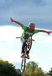 A member of Dialed Action Sports Team BMX performs a stunt during the Rotary festival Saturday at the Lycoming County Fairgrounds,