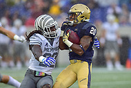 Annapolis, MD - September 8, 2018: Navy Midshipmen running back CJ Williams (20) is wrapped up by Memphis Tigers defensive back Tyrez Lindsey (22) during game between Memphis and Navy at  Navy-Marine Corps Memorial Stadium in Annapolis, MD. (Photo by Phillip Peters/Media Images International)