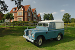 Very original 1977ish Landrover Series 3 Hardtop on a field with a large country house in background. Europe, UK, England, Surrey, Alfold. --- No releases available. Automotive trademarks are the property of the trademark holder, authorization may be needed for some uses.