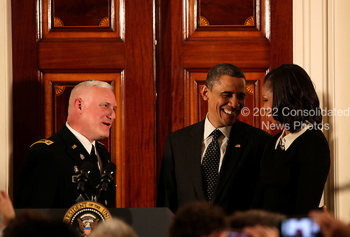 United States President Barack Obama, center, first lady Michele Obama, right, speak with Rabbi Larry Bazer, left, the Joint Forces Chaplain for the Massachusetts National Guard, at the end  of the Hanukkah Reception in the Grand Foyer of the White House  in Washington DC, on December 13, 2012..Credit: Aude Guerrucci / Pool via CNP