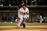 Birmingham Barons catcher Yermin Mercedes (6) checks the runner as he retrieves the baseball with umpire Matthew Brown looking on during a Southern League game against the Chattanooga Lookouts on May 1, 2019 at Regions Field in Birmingham, Alabama.  Chattanooga defeated Birmingham 5-0.  (Mike Janes/Four Seam Images)