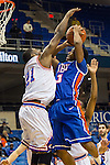 Texas-Arlington Mavericks forward Greg Gainey (21) blocks Houston Baptist Huskies guard Tyler Russell (3)during the game between the Houston Baptist Huskies and the Texas-Arlington Mavericks at the College Park Center arena in Arlington, Texas. UTA defeats Houston Baptist 81 to 47...