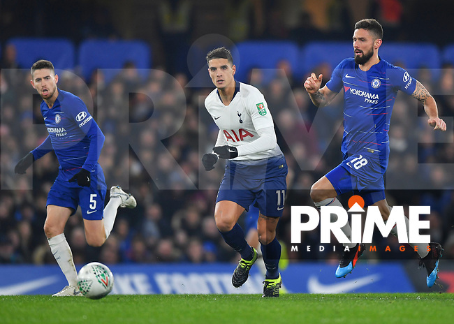 Erik Lamela of Tottenham Hotspur is chased by Olivier Giroud of Chelsea and Jorginho of Chelsea during the Carabao Cup Semi-Final 2nd leg match between Chelsea and Tottenham Hotspur at Stamford Bridge, London, England on 24 January 2019. Photo by Vince  Mignott / PRiME Media Images.