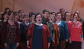 """London, UK. 19 November 2014. Chorus performing. Peter Sellars directs the World Staged Premiere of John Adams's """"The Gospel According To The Other Mary"""" at the London Coliseum. A Passion Oratory in Two Acts, Libretto by Peter Sellars based on Old and New Testament sources and with texts by Dorothy Day, Louise Erdrich, Primo Levi, Rosario Castellanos, June Jordan, Hildegard von Bingen and Ruben Dario. An ENO co-production with Theater Bonn and The Royal Swedish Opera. With Patricia Bardon as Mary Magdalene, Meredith Arwady as Martha, Russell Thomas as Lazarus and Daniel Bubeck, Brian Cummings and Nathan Medley as Seraphim. Dancers: Banks as Angel Gabriel, Stephanie Berge as Mary, Ingrid Mackinnon as Mary, Mother of Jesus and Parinay Mehra as Lazarus. The ENO orchestra was conducted by Joana Carneiro. Photo: Bettina Strenske"""