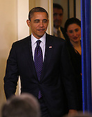 """United States President Barack Obama smiles slightly as he enters the Brady Press Briefing Room after signing H.R. 3765  """"Temporary Payroll Tax Cut Continuation Act of 2011"""" in the Oval Office on Friday, December 23, 2011. .Credit: Dennis Brack / Pool via CNP"""