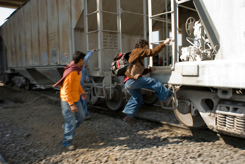 """Three Honduran immigrants on their way to the US catch the train known as """"El Tren de La Muerte"""" (the train of death) because so many immigrants have been killed riding it or by falling off or murdered by gangs. Lecheria, Estado de Mexico, Mexico. Wednesday, Feb. 13, 2008"""