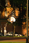Male playing basketball, North Park Blocks, Portland, Oregon