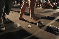 During the 2006 FIFA World Cup Final some fans were distracted by playing some street football instead of watching the final match on large outdoor public screens at the FIFA World Cup Fan Fest in Tiergarten park in Berlin. The game was held at the Olympic Stadium in Berlin, Germany on Sunday July 9th, 2006. Italy won on penalty-kicks, 5-3, over France after the match ended up in a draw in regulation and extra time