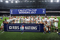 England players pose for a photo with the Calcutta Cup after the match. RBS Six Nations match between England and Scotland on March 11, 2017 at Twickenham Stadium in London, England. Photo by: Patrick Khachfe / Onside Images