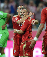 FUSSBALL   1. BUNDESLIGA  SAISON 2012/2013   5. Spieltag FC Bayern Muenchen - VFL Wolfsburg    25.09.2012 Jubel nach dem Tor Franck Ribery mit Xherdan Shaqiri (v. li., FC Bayern Muenchen)