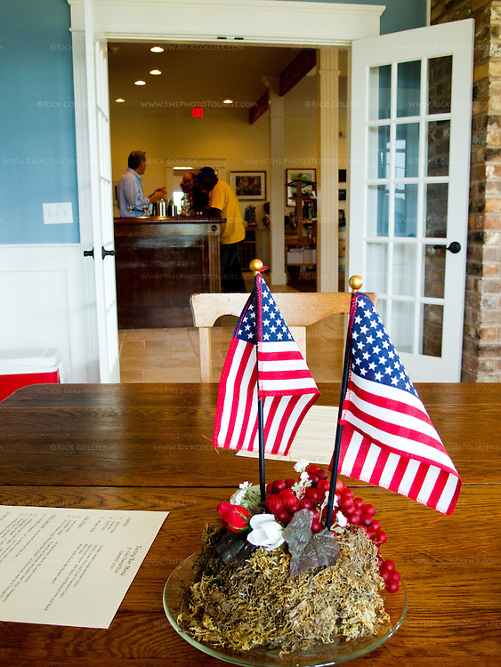 The centerpieces on the tables in the dining room featured American flags; the tasting bar is visible through the door beyond.  (Rosemont Vineyards and Winery)