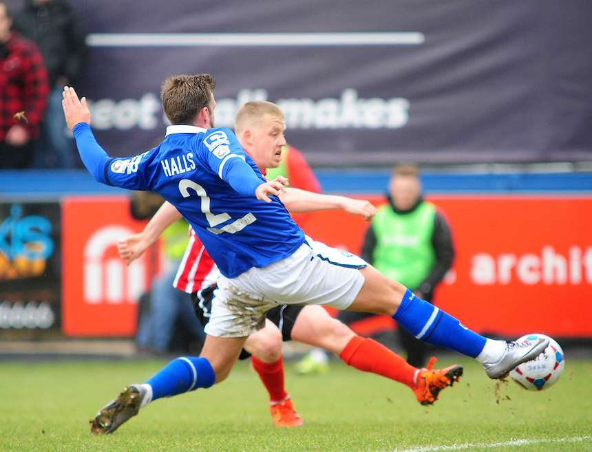 Lincoln City&rsquo;s Terry Hawkridge vies for possession with Macclesfield Town's Andy Halls<br /> <br /> Photographer Andrew Vaughan/CameraSport<br /> <br /> Football - Vanarama National League - Macclesfield v Lincoln City - Saturday 12th March 2016 - Moss Rose - Macclesfield<br /> <br /> &copy; CameraSport - 43 Linden Ave. Countesthorpe. Leicester. England. LE8 5PG - Tel: +44 (0) 116 277 4147 - admin@camerasport.com - www.camerasport.com
