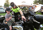 Carson City Sheriff&rsquo;s Sgt. Earl Mays shows Chayson Schierholt, 5, his motor unit during the 16th annual National Night Out event, hosted by the Carson City Sheriff's Office, in Carson City, Nev., on Tuesday, Aug. 7, 2018.<br />