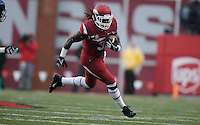 NWA Media/ J.T. Wampler -Arkansas' Alex Collins runs during the first quarter against Ole Miss Saturday Nov. 22, 2014.